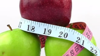 Rotating Fruits and Tape Measure: Stock Video