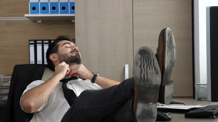 Young Businessman Relaxing: Stock Video