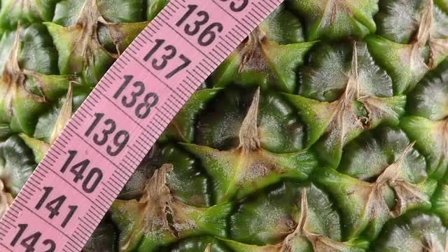 Pineapple And Measurement Closeup : Stock Video