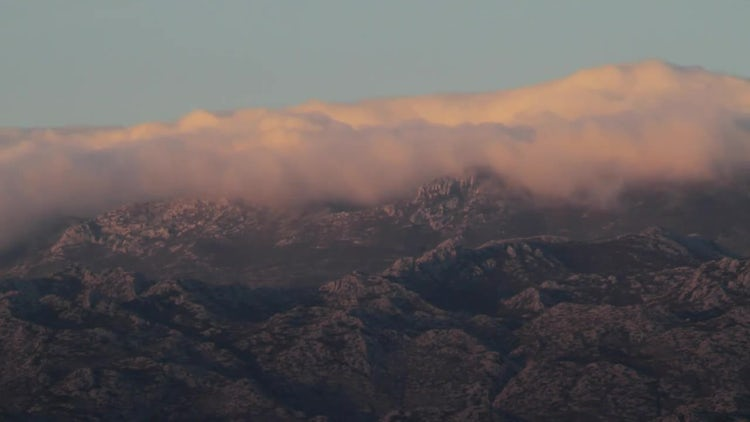 Clouds Roll Over Mountain Tops : Stock Video