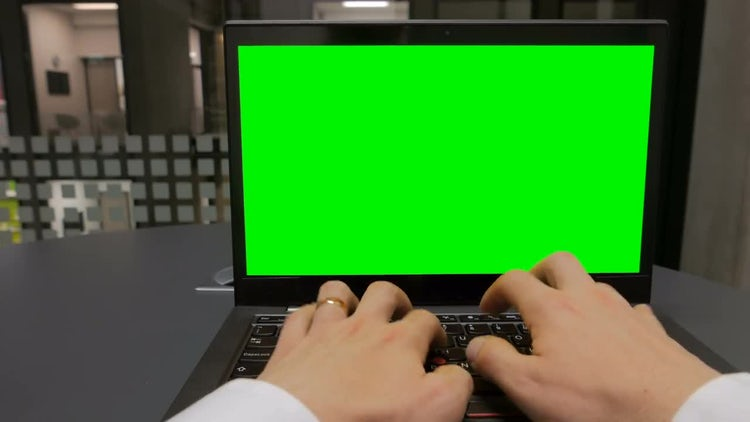 Typing On Green Screen Laptop: Stock Video