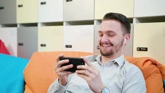 Man Watching Videos On Smartphone: Stock Video