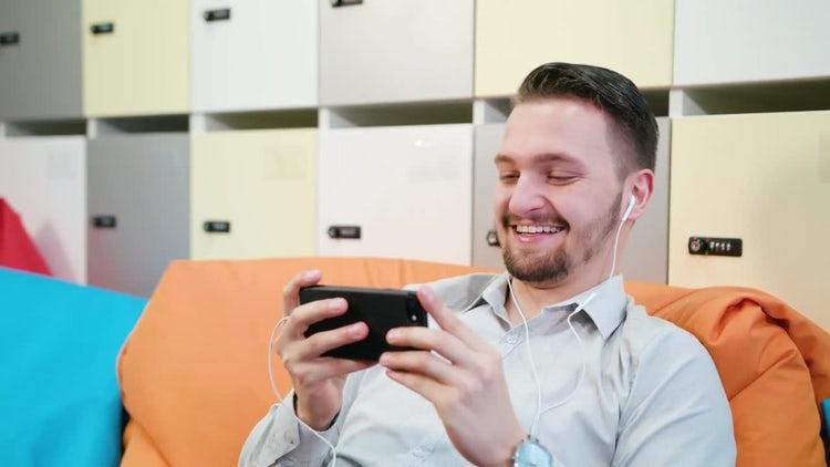 Man Watching Videos On Smartphone: Stock Video