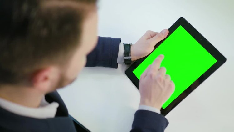 Man Using A Tablet With A Green Screen: Stock Video