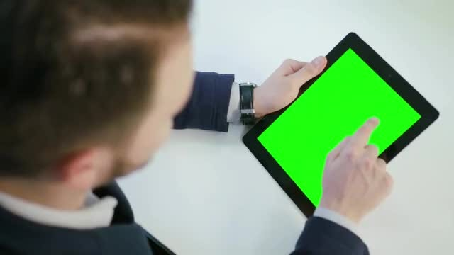 Man Using Tablet With A Green Screen: Stock Video