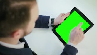 Looking At Green Screen Tablet: Stock Video