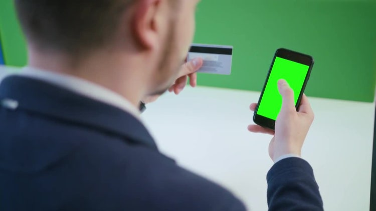 Man Using a Smartphone With Green Screen: Stock Video