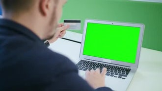 A Young Man Using A Laptop: Stock Video