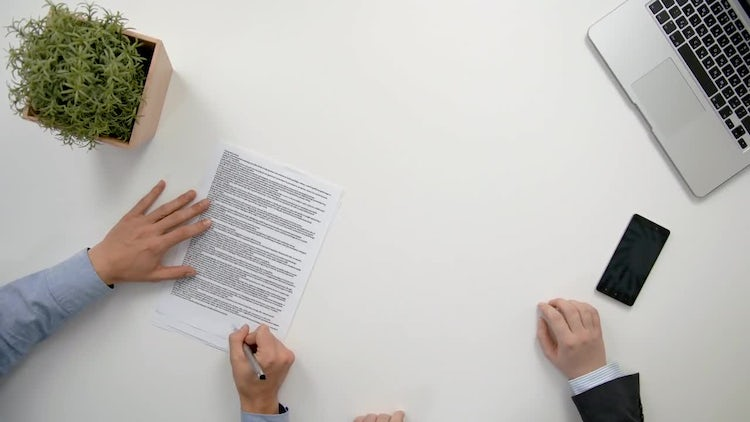 Hands Signing A Document: Stock Video