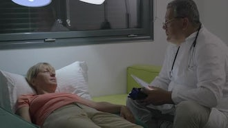 Doctor Consulting A Sick Woman: Stock Video
