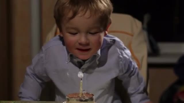 Kid Blowing His Birthday Candle: Stock Video