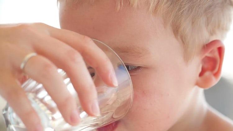 Little Boy Drinking Fresh Water: Stock Video