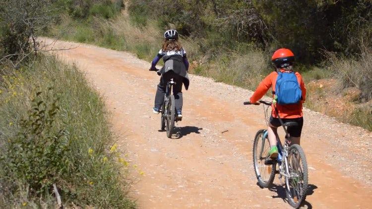 Family On Mountain Bikes: Stock Video