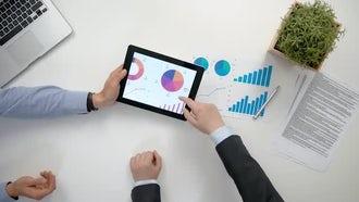 Businessmen Comparing Graphs: Stock Video