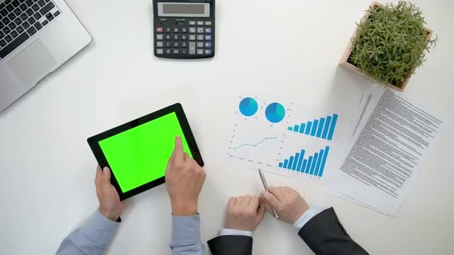 Businessmen Analyzing Business Graphs: Stock Video