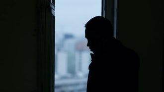 Silhouette Man Talking On Phone: Stock Video
