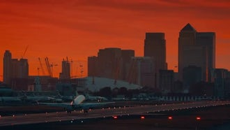 Airliner Landing During Sunset: Stock Video