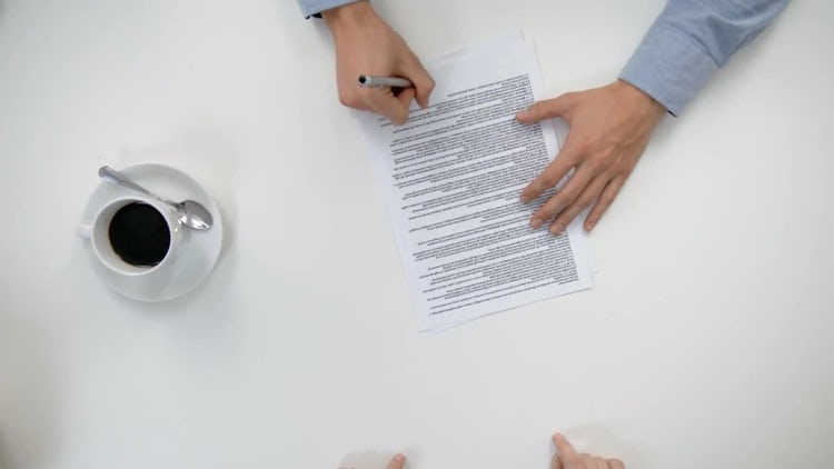 Men Signing A Document: Stock Video