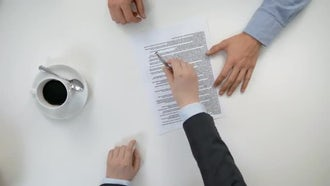 Men's Hands Signing a Document: Stock Video