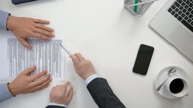 Men Reading A Document: Stock Video