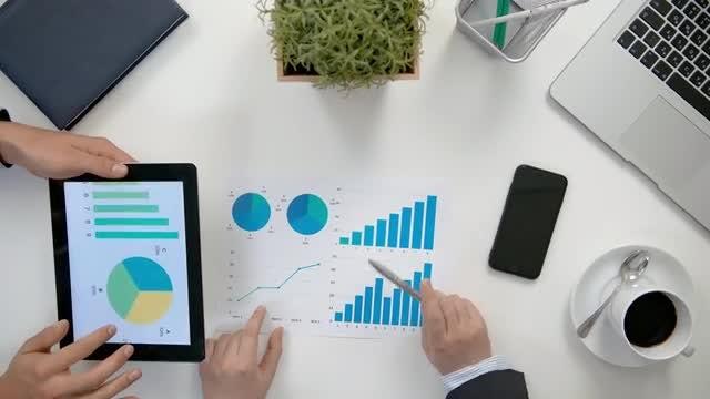 Businessmen Compare Diagrams: Stock Video