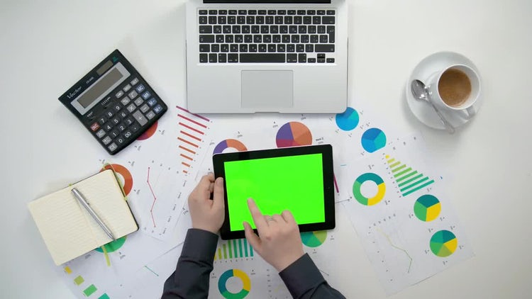 Swiping A Tablet With Graphs: Stock Video