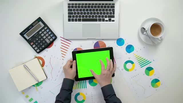 Swiping And Scaling A Tablet With Graphs: Stock Video