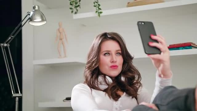 A Young Lady Taking Selfie Indoors: Stock Video