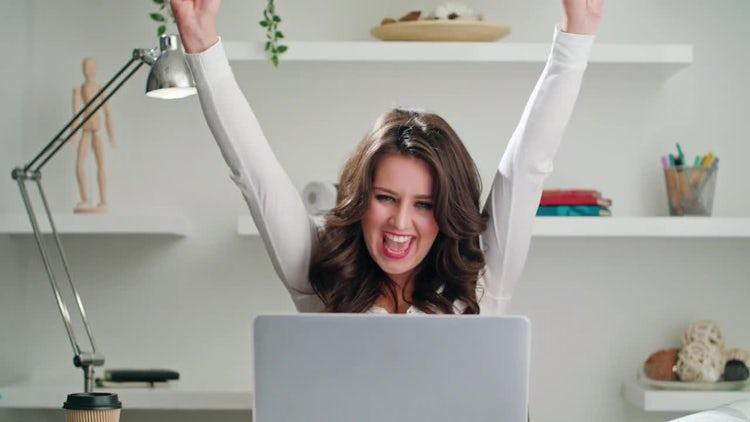Lady Celebrates While On Laptop: Stock Video