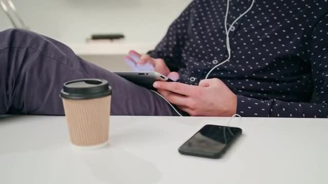 A Young Man Using A Tablet Indoors: Stock Video
