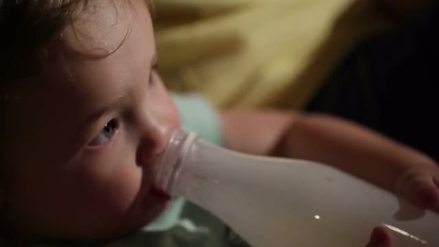 Boy Drinks Yogurt From A Bottle: Stock Video