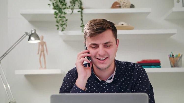 Young Man Talking On Phone: Stock Video