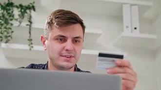 Man Using Credit Card On Laptop: Stock Video