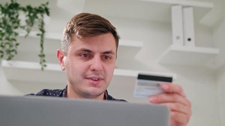 Man Using Credit Card On Laptop: Stock Video