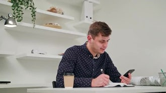 Young Man Taking Notes: Stock Video