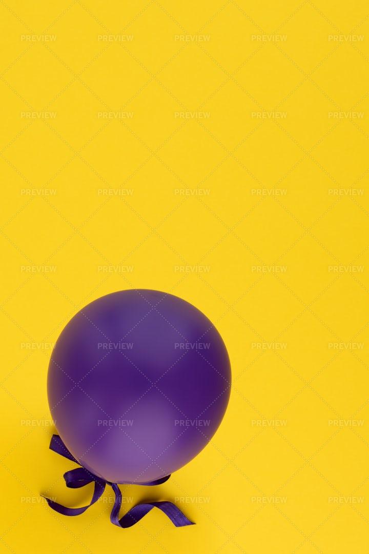 Purple Balloon On Yellow: Stock Photos