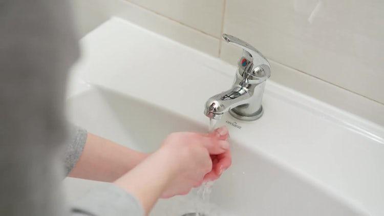 Woman Washing Hands In Bathroom: Stock Video