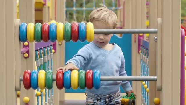 Boy Playing With An Abacus: Stock Video