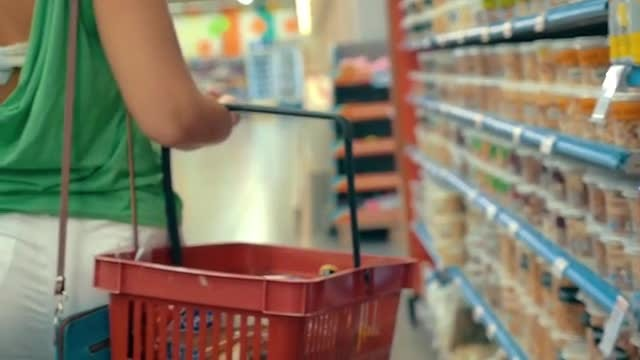 Woman Carrying A Shopping Basket: Stock Video
