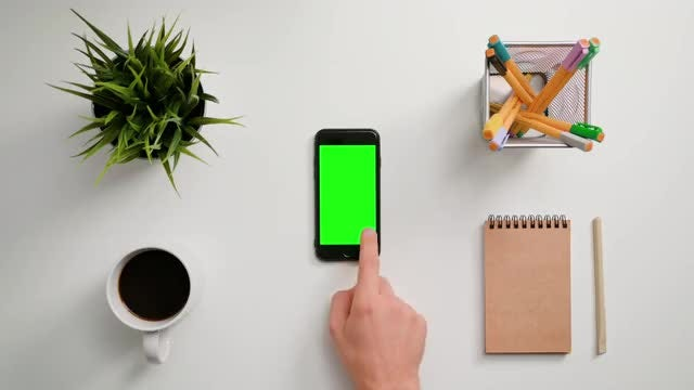 Man Scrolling On A Smartphone: Stock Video