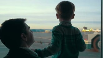 Father And Son By Window: Stock Video
