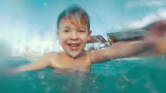 Boy Splashing In Pool: Stock Video