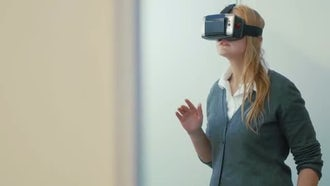 Woman Plays A Virtual Reality Game: Stock Video