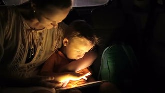 Mother-Son Reading On Travel: Stock Video