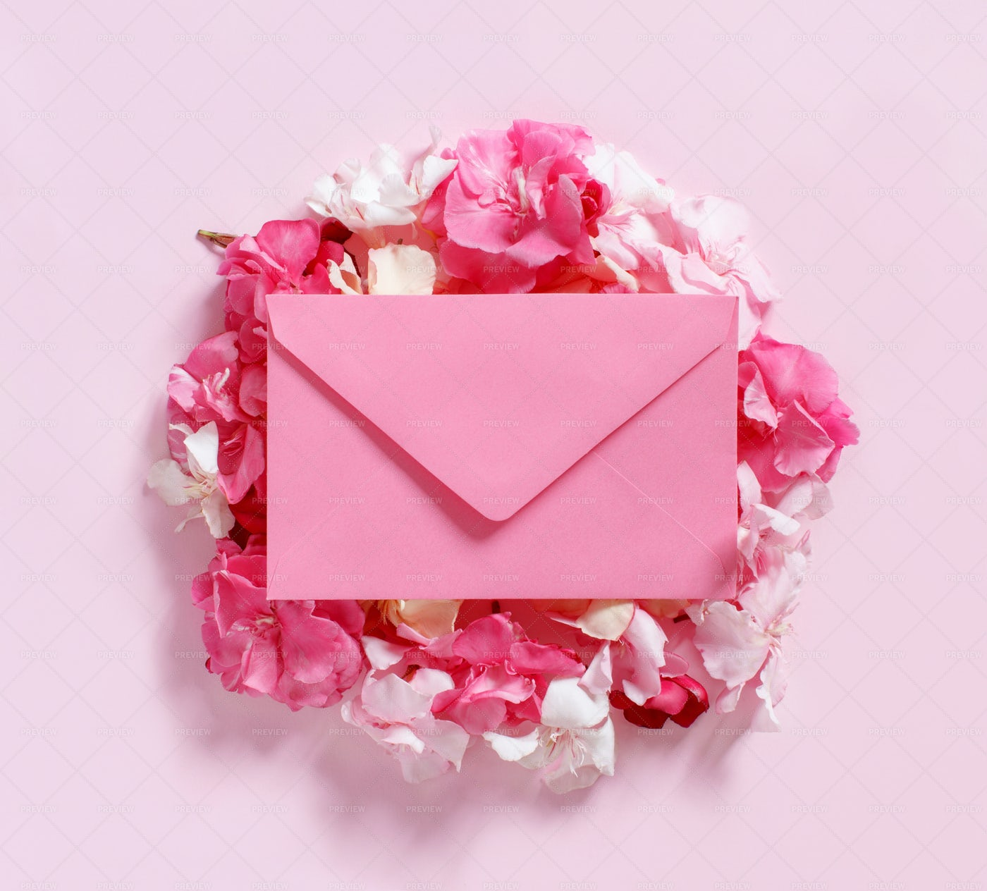 Pink Envelope On Flowers: Stock Photos