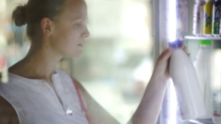 Woman Choosing Milk At Store: Stock Video