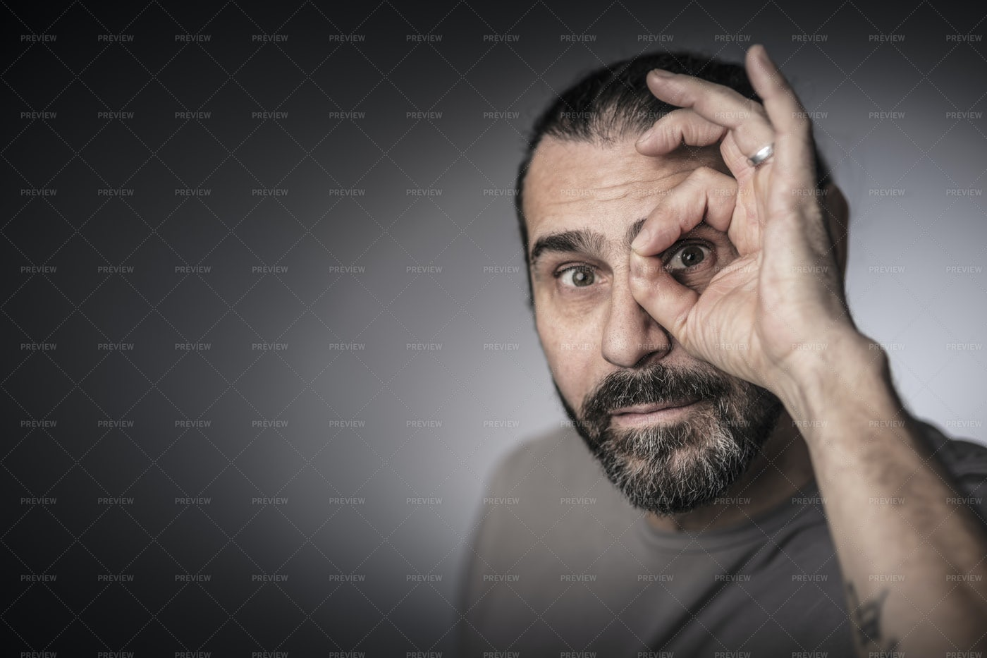 Looking Through His Fingers: Stock Photos