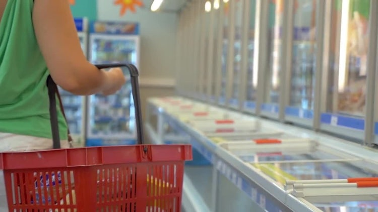 Woman At Frozen Section Of Supermarket: Stock Video