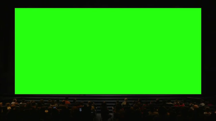 People In Auditorium With Green Screen: Stock Video