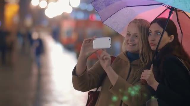 Women Taking Funny Selfies In City: Stock Video